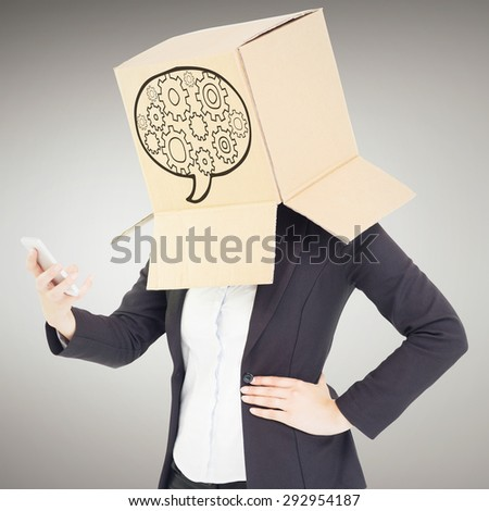Anonymous businesswoman with her hands up against grey vignette