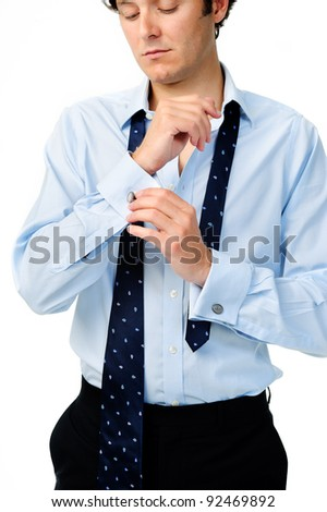 Anonymous caucasian man adjusts his cufflinks while preparing for work