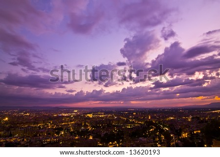 Anonymous city at sunset under cloudscape #13620193