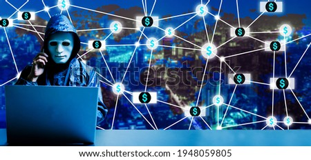 Anonymous computer hacker in white mask. He using laptop computer for cyber attack and talking to victims thru smartphone on digital world map city background, blackmailing people to get more money Foto stock ©