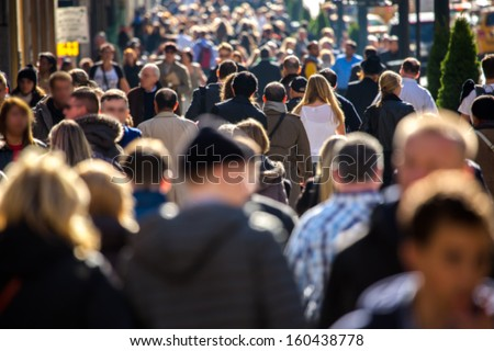 Anonymous crowd of people walking on a busy New York City street