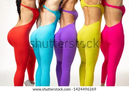 Anonymous females in multicolored skin tight sportswear