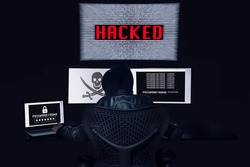 Anonymous hacking with 3 monitors and getting the password of the victim. Black background