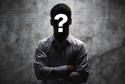 Anonymous man in a business shirt with question mark on his face on dark background