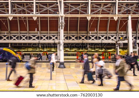 Anonymous people on a busy train station platform  #762003130