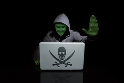 Anonymous with digit face with a stop hacking gesture. Dark background