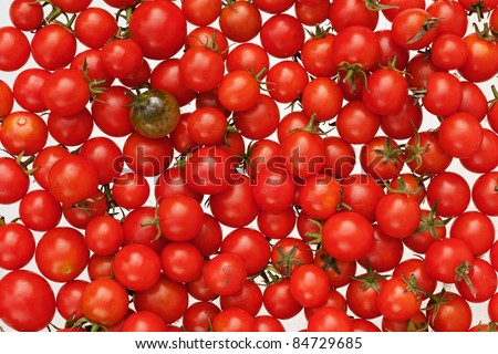 Another. Green and Red Cherry tomato Background. A cherry tomato is a smaller garden variety of tomato.