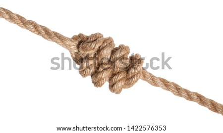 another side of multiple figure-eight knot tied on thick jute rope isolated on white background