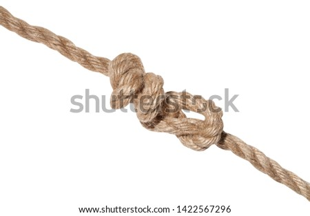 another side of stevedore knot tied on thick jute rope isolated on white background
