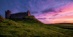 Another sunset: Roche Castle staring at relish and pinkish Sunset in County Louth, Ireland