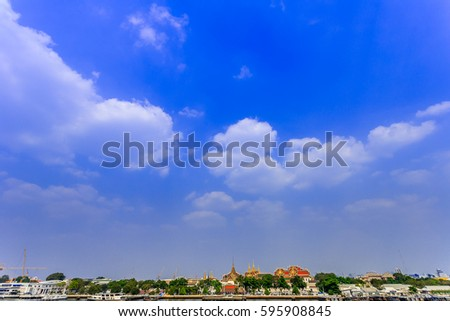 Another view of the Chao Phraya River in Thailand overlooks the palace as a tourist attraction. #595908845