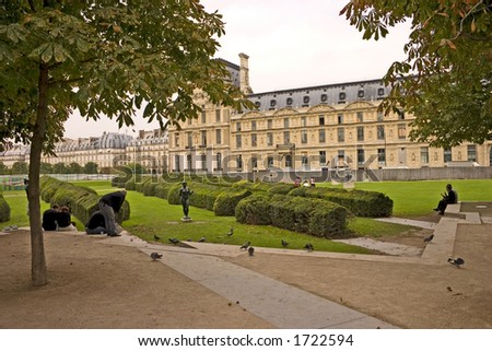Another view of the Tuileries gardens in Paris on a cloudy day.