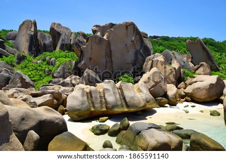 Anse Marron beach with big granite boulders on La Digue Island, Seychelles. Tropical landscape with sunny sky. Exotic travel destination. Photo stock ©