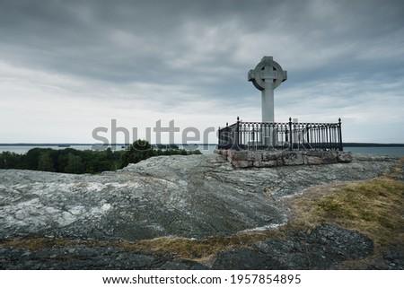 Ansgars Cross on the rocky shore of Birka, Björkö island, lake Mälaren, Sweden. Atmospheric landscape. Nature, travel destinations, tourism, landmarks, sightseeing, monument, history, viking age, art Stock fotó ©