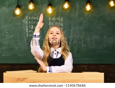 answer. i know the answer. answer to any question. girl hold raised hand because she knows the answer
