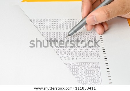 Answer Sheet and Holding Hand with pen