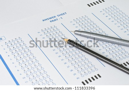 Answer Sheet with pen and pencil