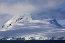 Antarctic coastal mountains from an Antarctic cruise ship cruising on a Polar Region voyage off the Antarctic scenery of the Antarctica coast