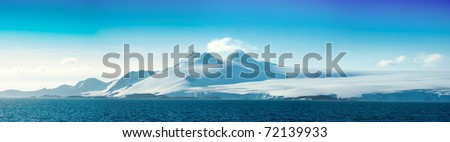 Antarctic ice island  in blue ocean. Orkney Islands. Summer season.