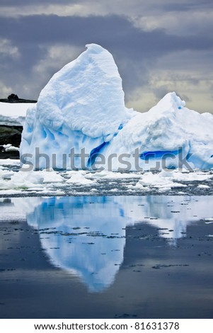 Antarctic iceberg in the snow. Beautiful winter background.
