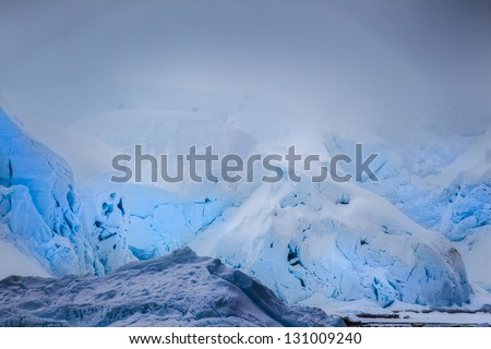 Antarctic icebergs with different shade of cold blue