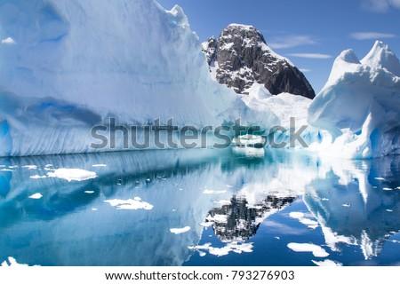 Antarctic Landscape with icebergs in foreground. Antarctic Peninsula, Antarctica
