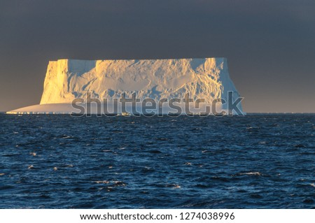 Antarctic Sunset: Floating Icebergs in the Weddell Sea, near the Antarctic Peninsula, as seen from an Antarctic Exploration Ship #1274038996