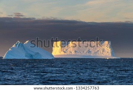 Antarctic Sunset: Floating Icebergs in the Weddell Sea, near the Antarctic Peninsula, as seen from an Antarctic Exploration Ship #1334257763