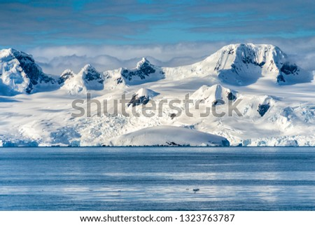 Antarctica mountains and sea #1323763787
