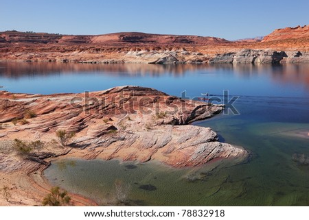 Antelope Canyon in the Navajo Reservation. Two boats with oars float near the water channel