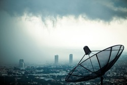 Antenna communication satellite dish with storm background