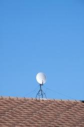 Antenna in the sky. TV antenna. White satellite antenna on the roof. TV antenna. Horizontal
