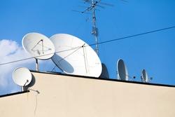 Antenna on Sky. Television antenna. white satellite antenna on the roof. TV antenna. horizontal