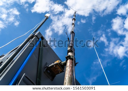 Antenna poles with a blue sky background and white clouds. Radio communication pole. Communication technology. Telecommunication industry.
