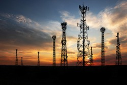 Antenna Telephone Network Communication Cable with Sunset Background