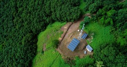antenna with solar panel in the mountains for aerial view, french polynesia