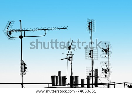 antennas and pipes on the rooftop