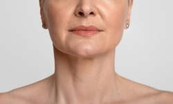 Anti-Aging Skincare. Cropped portrait of middle-aged woman with beautiful skin, light background, closeup
