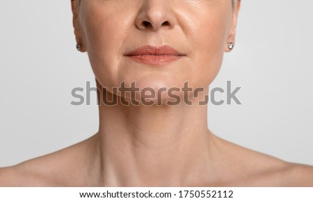 Anti-Aging Skincare. Cropped portrait of middle-aged woman with beautiful skin, light background, closeup Foto stock ©
