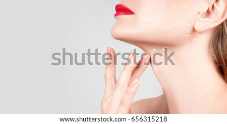 Anti-aging treatment and face lift. Beautiful woman neck with massage lines or lifting arrows