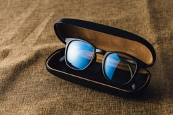 anti blue light glasses on brown cloth background