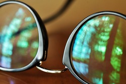 Anti-glare coating on eye glasses filters out short wavelength colors in the visible light spectrum.