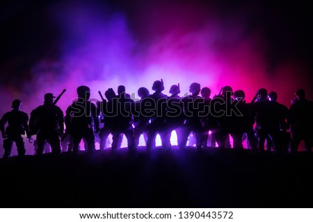 Anti-riot police give signal to be ready. Government power concept. Police in action. Smoke on a dark background with lights. Blue red flashing sirens. Dictatorship power #1390443572
