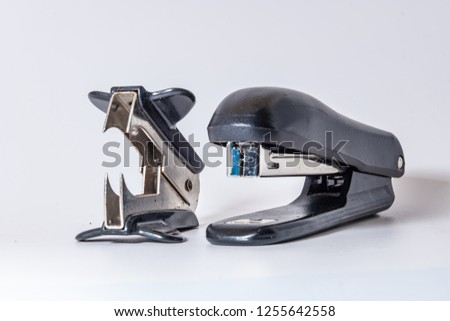 Anti-stapler and stapler on a white background close-up