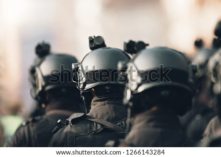 anti terrorism squad with military equipment with special tactical force counter terrorism assault technology