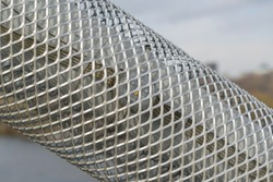 Anti-vandal metal mesh on design with LED backlight. Concept of protection against advertising, vandals and hooligans.