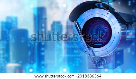 Anti-vandal surveillance system. Outdoor CCTV camera close-up. CCTV camera symbolizes surveillance. Abstract tech background behind camera. Concept - sale of video surveillance system.