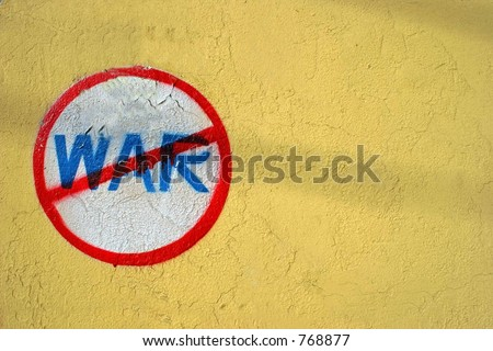Anti-war sign on a yellow wall