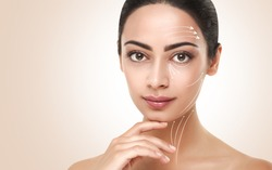 Antiaging treatment. Massage and contouring lines on neat model