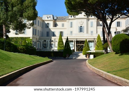 ANTIBES, FRANCE-JUNE 11: Eden Roc Hotel shown on june 11, 2014 in Antibes, France. This 5-star hotel of 117 suites welcomes numerous celebrities and organizes the most parties of Cannes film festival.